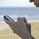 Using Mobile Phone On Beach - VideoHive Item for Sale